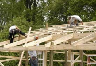 Workers Working with Wooden Truss